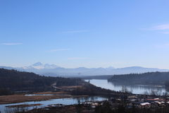 View of Fraser River and Mt. Baker from Ruskin. A view of the Fraser River looking south towards Mount Baker  in Washington. Image shot from 284th Street in Stock Photography