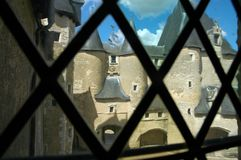 View. French castle seen through an old glass window Royalty Free Stock Images
