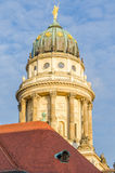 View on French Cathedral with red tiled roof in foreground at Gendarmenmarkt square in Berlin, Germany Royalty Free Stock Photos
