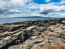 View of Frenchman Bay and Mount Desert Island from Schoodic Shoreline Stock Photo