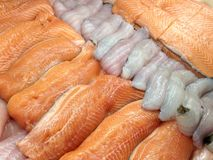 Seafood in the store. View at the fresh fish fillets on the ice in the store display case Royalty Free Stock Images