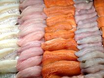 Seafood in the store. View at the fresh fish fillets on the ice in the store display case Royalty Free Stock Photography