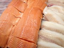 Seafood in the store. View at the fresh fish fillets on the ice in the store display case Stock Photography