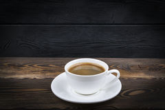 Overhead view of a freshly brewed mug of espresso coffee on blue rustic wooden background with woodgrain texture. Coffee break Royalty Free Stock Photography