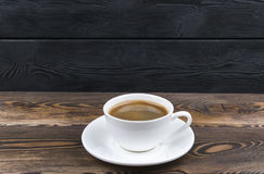 Overhead view of a freshly brewed mug of espresso coffee on blue rustic wooden background with woodgrain texture. Coffee break Stock Photo