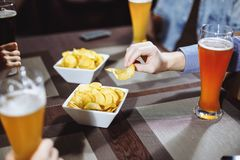 View on friends having alcoholic drinks in the bar, close-up. royalty free stock image