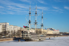 A view of the frigate `Blagodat` and Peter`s embankment, sunny January day. Saint Petersburg Stock Photography