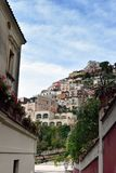 Positano houses above street. View fro a tiny sidestreet to the houses that cover the steep hillside of Positano, Italy royalty free stock photos