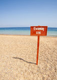 View From A Tropical Beach With Swimming Sign Stock Photography