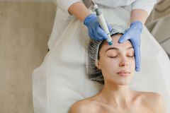 Free View From Above Of Beautiful Woman Enjoying Cosmetology Procedures, Rejuvenation In Beauty Salon. Dermatology, Doctor At Stock Image - 149064981
