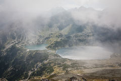 View From Eagle`s Path In Tatra Mountains To Five Polish Ponds Valley Though The Clouds Stock Images