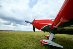 View of the front of the aircraft with a propeller against the s Stock Photo