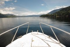 View from the front of the moving boat. Trip by the beautiful blue lake royalty free stock images