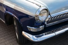 View of the front part of a retro car of blue colour.  royalty free stock photos