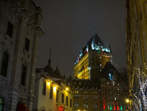 View of Frontenac Castle Chateau de Frontenac, in French in winter under icy snow in the night. Royalty Free Stock Photos