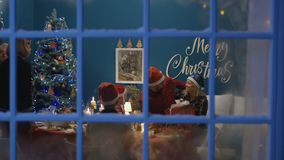 Excited family exchanging with presents at Christmas stock video