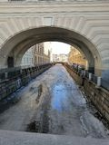 view of the frozen canal, arches and bridge stock photos
