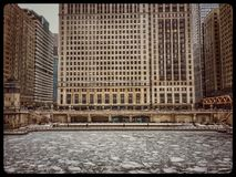 View of frozen Chicago River and snowflakes during heavy morning snowfall. Royalty Free Stock Images