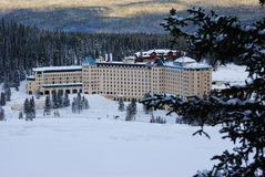 View of frozen lake and famous hotel in National Park, Canada Royalty Free Stock Images