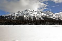 A view of frozen lake and mountains and people in the alps switzerland Stock Photo