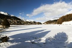 A view of frozen lake and mountains and people in the alps switzerland Stock Photography