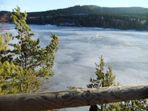 A view on the frozen lake. Winter day in the mountains Royalty Free Stock Photo
