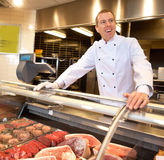 View of frozen meat with cheerful chef Royalty Free Stock Images