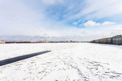 View of frozen Neva river with polynya in Fortress. View of frozen Neva river with polynya, Dvortsovaya Embankment and Peter and Paul Fortress in Saint Royalty Free Stock Photo