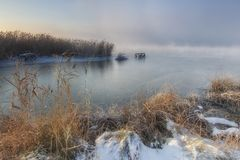 View of the frozen river in the winter foggy morning.  royalty free stock photo