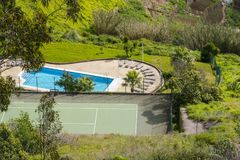 View of Funchal from the Cabo Girao. View of swimming pool and tenis court  in Funchal from the Cabo Girao . Madeira Island, Portugal. Panorama, residential Royalty Free Stock Images