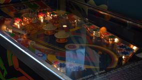 View of functioning classic table pinball in museum of old slot-machines. View of bright working classic table pinball with colorful lighting in museum made of stock video footage