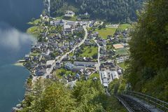 View of a funicular rail leading to a skywalk view in Austria with hallstatt village in the background. stock photo