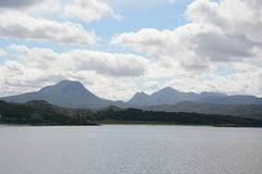 View from Gairloch of Church, Beach and Mountains Stock Images