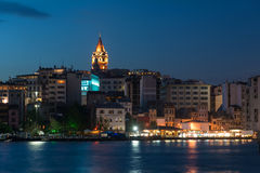 View of Galata district with Galata Tower at night in Istanbul Stock Photo
