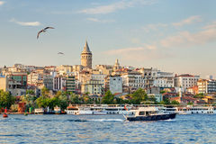 View of Galata district at sunset, Istanbul. Cityscape with Galata Tower over the Golden Horn at sunset, Istanbul, Turkey royalty free stock images