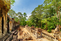 View of galleries and ruins of ancient Ta Keo temple in Angkor Stock Images