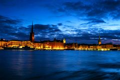 View of Gamla Stan in Stockholm, Sweden with landmarks like Riddarholm Church during the night royalty free stock photos