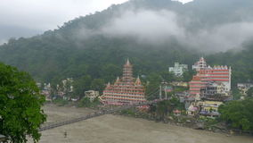 View of Ganges River in Rishikesh and Many people were walking across the bridge. stock footage
