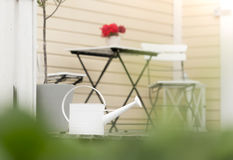 View on garden chairs, table, flower pot and  house. Sweden, Europe, Scandinavia. Stock Images