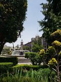 View of a garden with fountain in the main square of the city of Toluca, Mexico. View garden fountain main square city toluca mexico travel tourism vacation park royalty free stock image