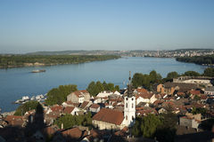 View from Gardos Hill - Zemun at Belgrade. View from Zemun Gardos Hill. St. Nicholas Church in foreground. Sava river in the middle, Belgrade cityscape in the Royalty Free Stock Images