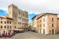 View at the Garibaldi place with building of Town hall in Massa Marittima - Italy royalty free stock photos