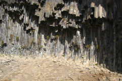 The view of Garni basalt Canyon in Armenia. Basalt five corner, pentagonal stone columns in the river canyon Royalty Free Stock Image