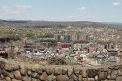 View from Garret Mountain to Paterson city NJ USA. View of the big city and the verdant hills of New Jersey. In the foreground a stone wall royalty free stock photos