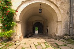 View of gate and old cannon near the enterance in ancient Olesko castle. Courtyard in castle. Lviv region in Ukraine. Cloudy summe stock images