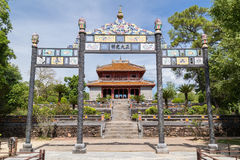 View of gate and pavilion in Imperial Minh Mang Tomb in  Hue Royalty Free Stock Photography