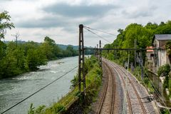 View of the Gave de Pau and the railway line. A view of the Gave de Pau and the railway line royalty free stock image