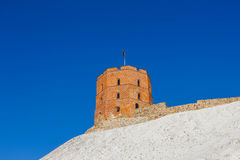 View on Gediminas tower on the castle hill in the old town of Vilnius city in Lithuania. At winter. This tower is very popular tourist destination in Vilnius royalty free stock photos