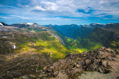 View of Geiranger. The Geiranger fjord in Norway, surrounded by high mountains Stock Photo