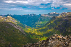 View of Geiranger. The Geiranger fjord in Norway, surrounded by high mountains Stock Photos